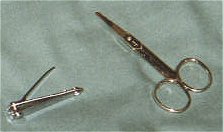 Fingernail clippers (left) and nosehair scissors (right).